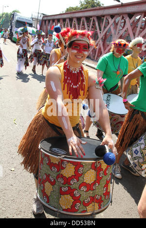 London, UK. 26 August 2013. Drummers entertain crowds on Kensal Road. Credit: David Mbiyu/ Alamy Live News - Stock Photo