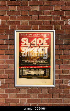 Framed poster advertising 70's British pop groups Slade and Sweet in concert UK - Stock Photo