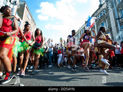 London, UK - 26 August 2013: revellers dance during the annual parade at the Notting Hill Carnival. - Stock Photo
