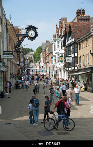 Winchester city centre. High Street shoppers in the pedestrian zone - Stock Photo