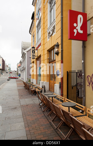 Old cinema building in Tromso with street cafe - Stock Photo