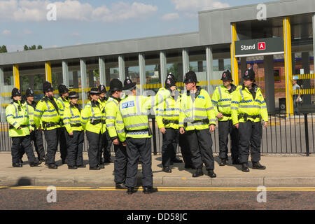 Bolton, Lancashire, UK. 26th Aug, 2013. A heavy police presence is deployed around Trinity Street,  Bolton to monitor - Stock Photo