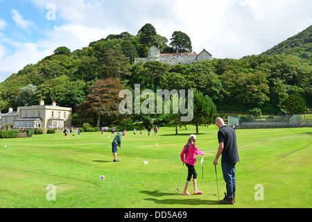 Manor Tennis & Putting Green with The Tors Hotel behind, Lynmouth, Devon, England, United Kingdom - Stock Photo