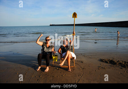 Newhaven, Sussex, UK. 26 Aug, 2013. Defiant local residents Teresa Owen and Clare Furminger on Newhaven beach protest - Stock Photo