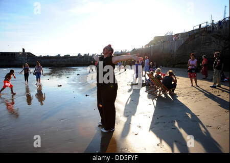 Newhaven, Sussex, UK. 26 Aug, 2013. Local residents from Newhaven enjoy the bank holiday on the closed off beach - Stock Photo