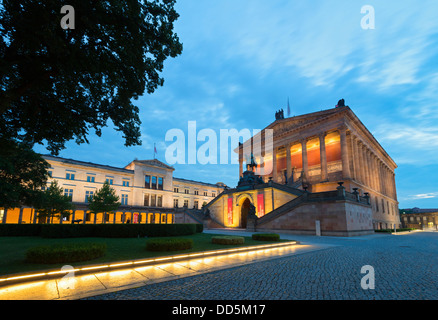 Evening view of Neues Museum on left and Alte Nationalgalerie on Museumsinsel or Museum Island in Berlin Germany - Stock Photo