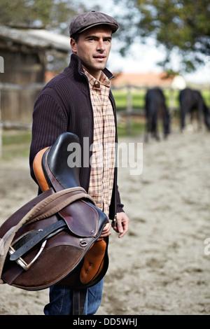 Man Holding Saddle, Baranja, Croatia, Europe - Stock Photo