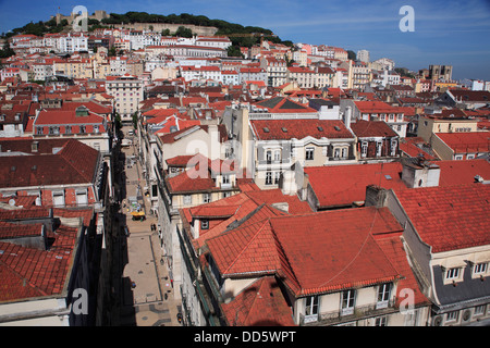 Portugal, Estremadura, Lisbon, View across Baixa with Sao Jorge Castle & Se Cathedral in the background. - Stock Photo