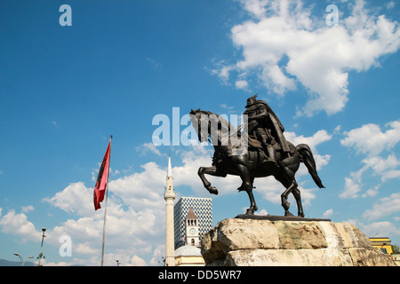 Statue Albanian national hero George Kastrioti Skanderbeg on his horse, in the main square of Tirana, the capital - Stock Photo