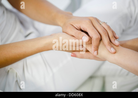 Doctor's Visit, Holding Hands, Close-up - Stock Photo