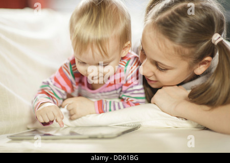 Children using digital tablet, Osijek, Croatia, Europe - Stock Photo
