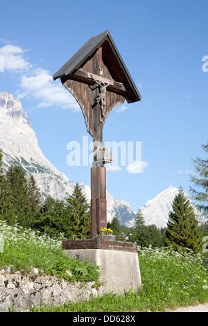 crucifix in cortina d'ampezzo in the italian dolomites near cortina d'ampezzo - Stock Photo