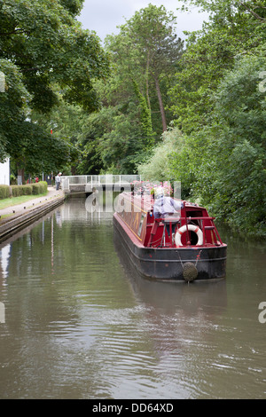 A narrowboat (barge) approaching the Theale swing bridge on the Kennet and Avon canal Berkshire. - Stock Photo