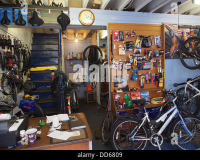 old fashioned bicycle repair shop interior - Stock Photo