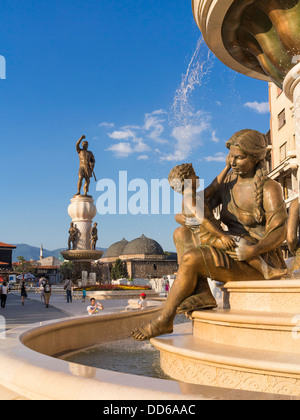 The Mothers of Macedonia Fountain, Skopje, Macedonia in Rebellion Square with the new Warrior Monument behind - Stock Photo