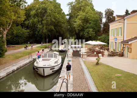 People watching as boats enter a lock on the Garonne canal, Lot et Garonne, France Europe - Stock Photo