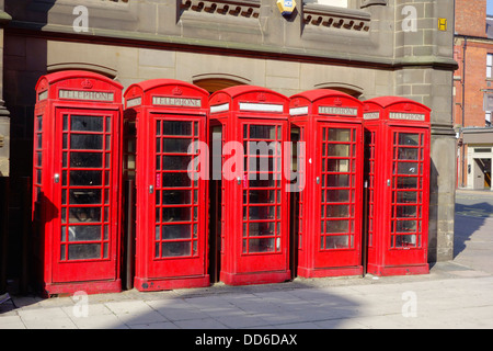 Five classic red British telephone type K6 boxes now disused - Stock Photo