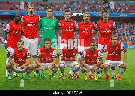 London, UK. 27th Aug, 2013. The Arsenal team line up before the UEFA Champions League Qualification round match - Stock Photo