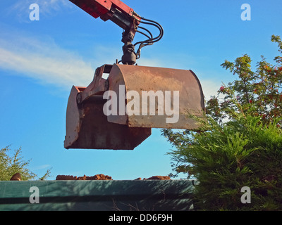 Earth Mover on Boom Loading Truck with soil - Stock Photo