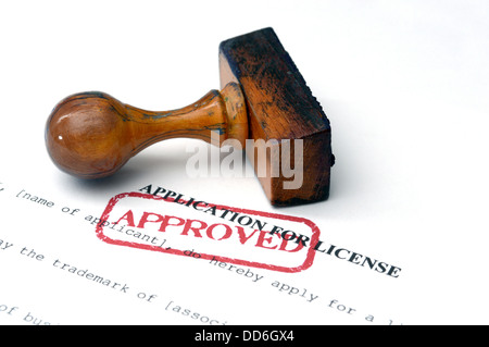 Application for license on white paper approved with stamp - Stock Photo
