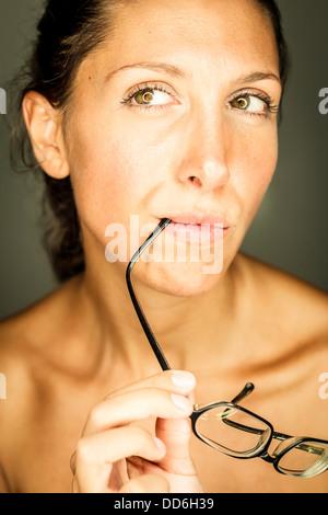 Studio, Junge Frau mit Brille - Stock Photo