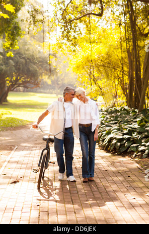 cute senior couple walking outdoors at the park - Stock Photo