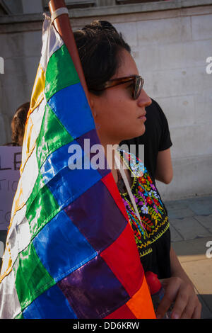London, UK. 27th Aug, 2013. A woman listens to speeches as Colombians in London demonstrate in solidarity with farmers - Stock Photo