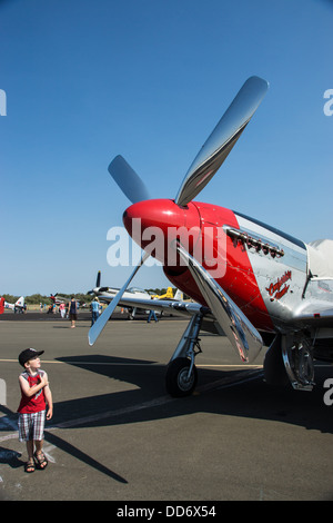 8/18/2013 Santa Rosa, California. Young boy looking up at North American P-51 Mustang at the Pacific Coast Air Museum - Stock Photo