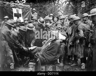 Wounded German prisoners receiving medical attention at first-aid station of 103rd and 104th Ambulance Companies. - Stock Photo