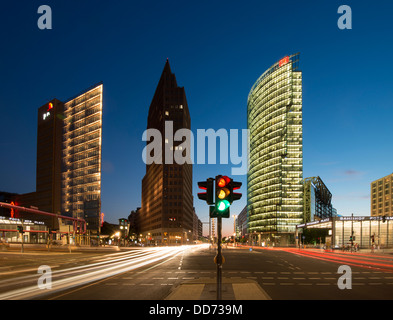Night view of skyline of high rise buildings in Potsdamer Platz in Mitte Berlin Germany - Stock Photo