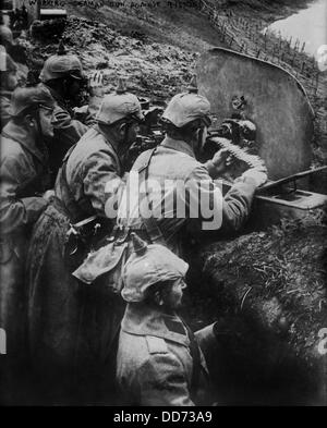 German WW1 machine gun crew firing from a trench on the Eastern Front. 1914-15. (BSLOC_2012_4_127) - Stock Photo