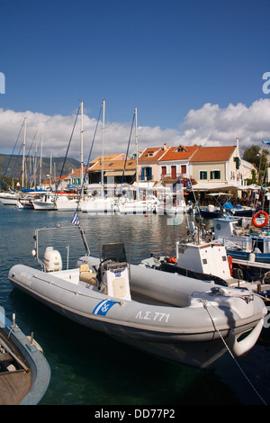 Boats in the harbour at Fiskardo, on the Greek island of Kefalonia. - Stock Photo