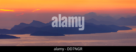 Sunset near Dubrovnik in south Croatia. View to Peljesac peninsula and Islands near by - Stock Photo
