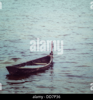and old, almost sunken wooden boat - Stock Photo
