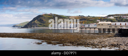 UK, Wales, Ceredigion, Aberystwyth, seafront and pier at low tide, panoramic
