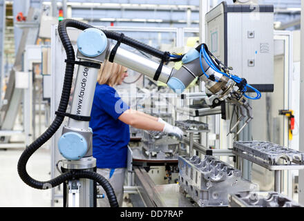 (HANDOUT) A handout photo provided by VW on 04 February 2013 shows an industrial robot arm moving sensitive pencil - Stock Photo