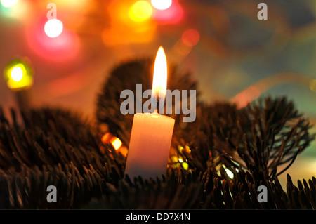 Christmas candle burning - Stock Photo