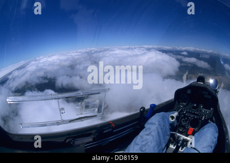 Inside view of glider plane flying over clouds during a wave flight, Aragon, Spain - Stock Photo