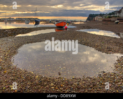 The vibrantly painted fishing boat 'Dixie',  in the  early morning light, on the shingle beds of the 'The Salty', - Stock Photo