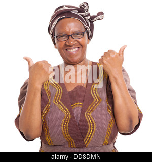 senior African woman giving two thumbs up as sign of approval - Stock Photo