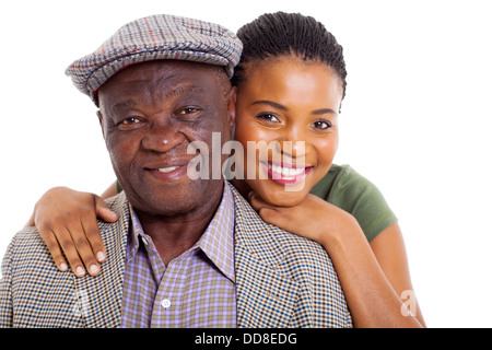 close up portrait of African daughter and senior father on white background - Stock Photo