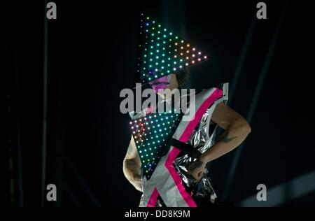 A member of the German band 'Deichkind' performs on stage in Hamburg, Germany, 28 August 2013. Photo: Sven Hoppe - Stock Photo