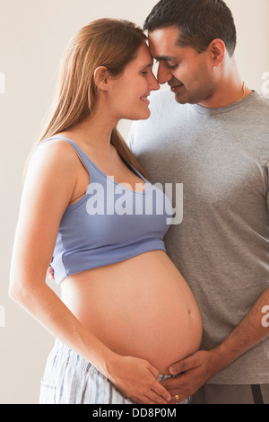 Man holding pregnant woman's stomach