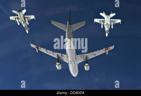 A Canadian Air Force CC-150 Polaris Airbus refueling aircraft from 437 Squadron Trenton provides air-to-air refueling - Stock Photo