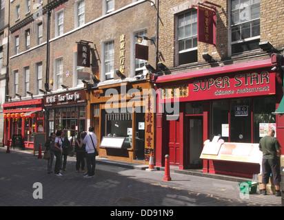 Chinese restaurants in Lisle Street Chinatown Soho London - Stock Photo