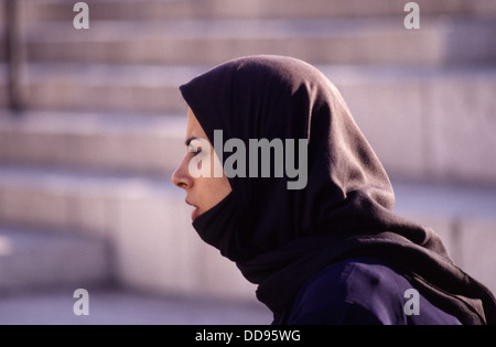 A young woman wearing a Chador headdress in the old city East Jerusalem Israel - Stock Photo