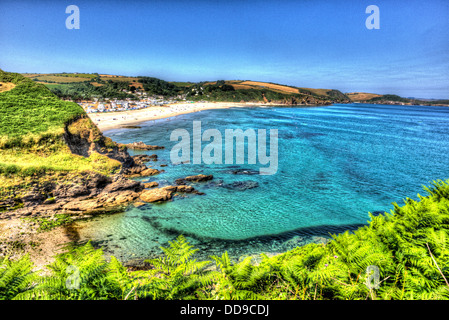 Cornwall coast at Pentewan with blue and turquoise sea and sky in HDR - Stock Photo