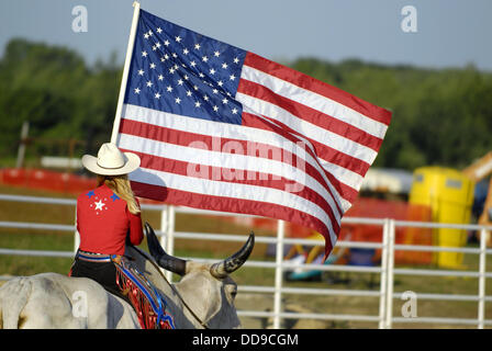 Cowgirl Carrying American Flag Riding Palomino Horse And