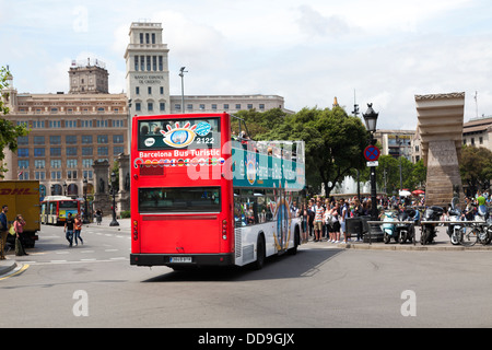 Open top tourist bus in Plaza de Catalunya Barcelona - Stock Photo