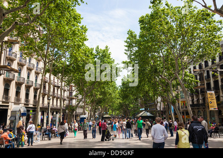 La Rambla pedestrian tourist street in Barcelona - Stock Photo